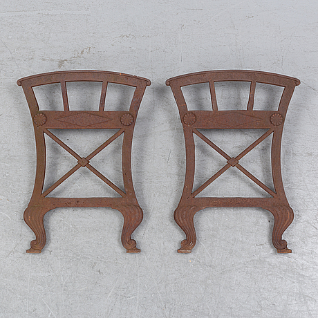 A cast iron garden bench parts/sides, a pair,  by folke bensow, näfverqvarns bruk. first half of the 20th century.