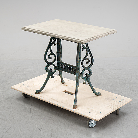 A early 20th century cast iron garden table with later concrete top.