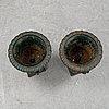 A pair of cast iron garden urns.