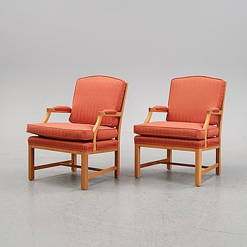 A pair of beech wood armchairs from JIO, 21st Century.