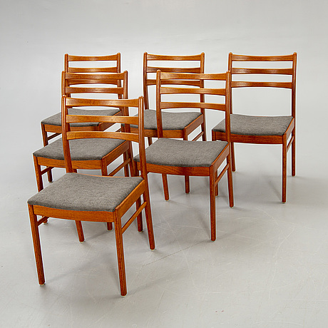 A set of six t1960s teak dining chairs.