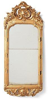 87. A Swedish Rococo mirror.