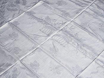 "264. A tea table cloth, linen damask, ""Lilla blomsterkorgen"", ca 143,5 x 144 cm."