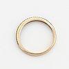18k gold and small brilliant-cut diamond ring.