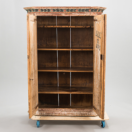 A 1805 dated cupboard marked ees åt.