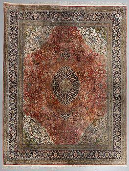 A carpet, Old oriental silk, ca 350 x 275 cm.