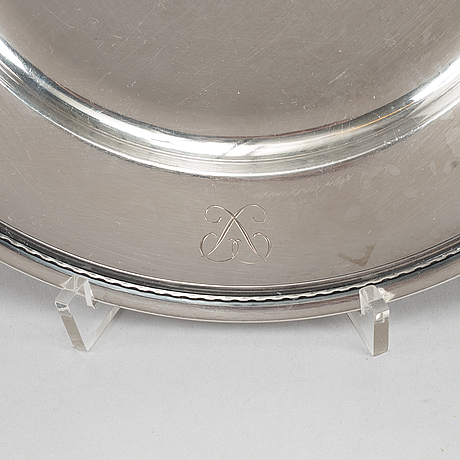 A swedish silver dish and two plates,cf carlman, stockholm 1912, and  gab, stockholm 1961.