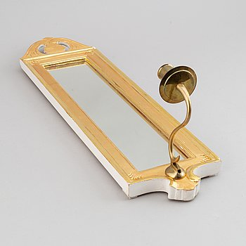 A 'Regnaholm' Gustavian style mirror sconce from Ikea, 1990.