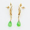 Baguette cut diamond and green stone earrings.