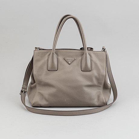 Prada, a leather handbag.