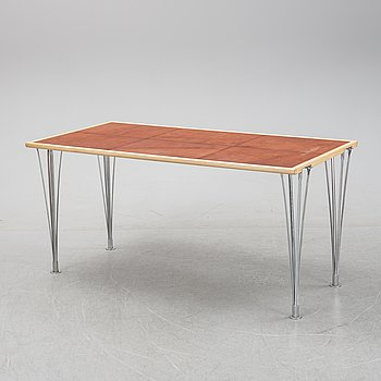 A birch and leather dining table produced by Mathsson International, 21th century.
