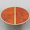 A birch and leather dining table in two parts, mathsson international, 21th century.