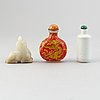 Two chinese snuff bottles and one nephrite figurine, 20th century.