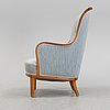An 'advokaten' easy chair by carl malmsten for oh sjögren, second half of the 20th century.