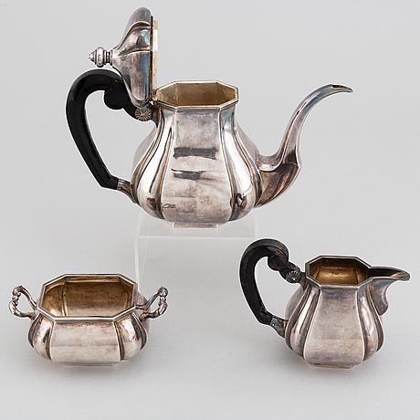 A silver coffee pot, creamer and sugar bowl, swedish import mark.