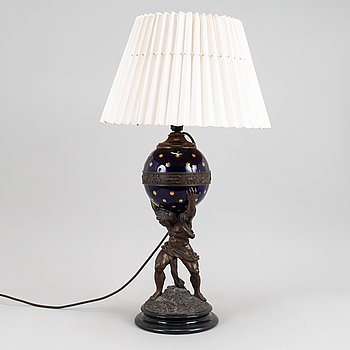 A patinated zinc and glass table lamp, turn of the century 1900.
