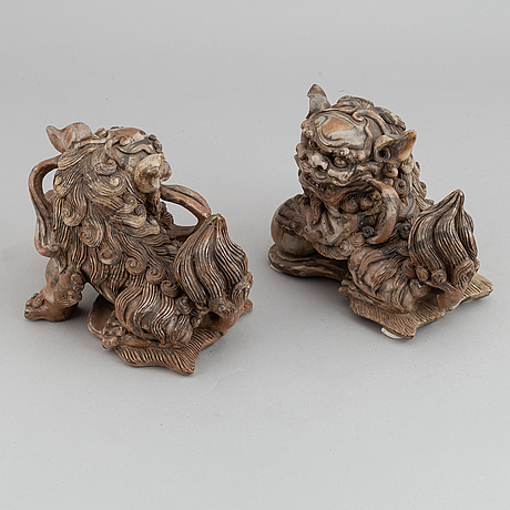 A pair of carved stone buddhist lions, late qing dynasty or early 20th century.