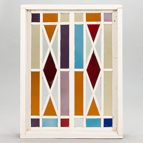 An early 20th century window with window frame.