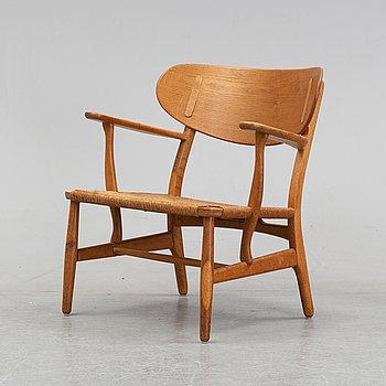 Hans J. Wegner, a 'CH 22' oak armchair, Carl Hansen & Søn, Denmark.