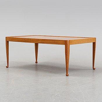 A model 2073 'Diplomat' coffee table by Josef Frank for Firma Svenskt Tenn.