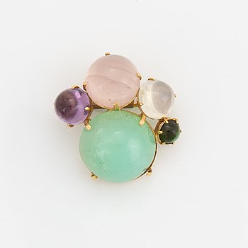 18K gold and cabochon stone brooch.
