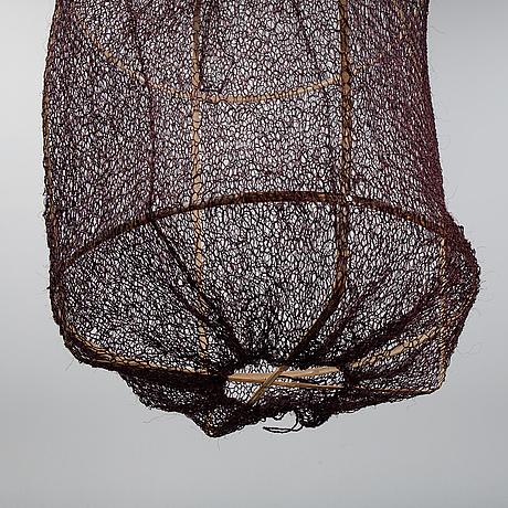 A 'z1 black' bamboo and sisal net ceiling light, ay illuminate.