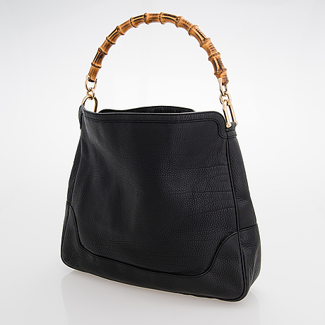 Gucci, a black leather bamboo handle bag.