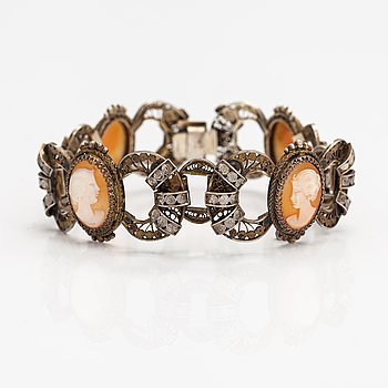 A silver and sea shell cameo bracelet.