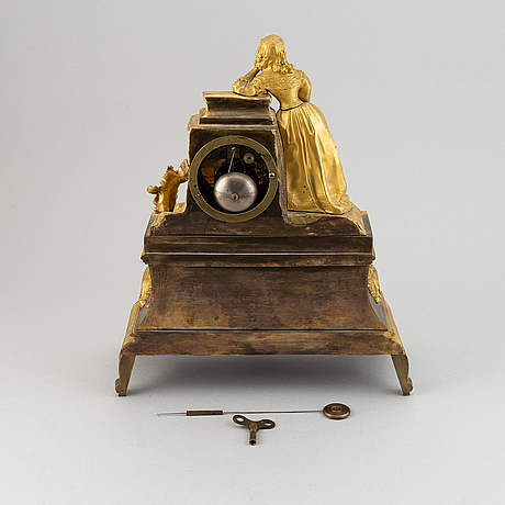 A rococo style brass mantle clock, second half of the 19th century.