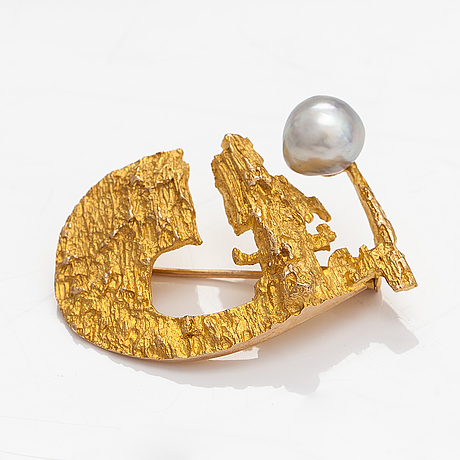 "Björn weckström, ""sun ship"", a 14k gold brooch with a cultured pearl. lapponia 1967."