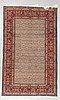 A carpet, moud, signed, ca 250 x 150 cm.