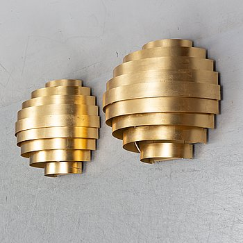 A pair of contemporary wall lights, 'Mamamia grande' designed by Theo & Silvia Sogni.