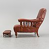 A late empire armchair with stool, mid 19th century.