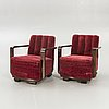A pair of 1940s easy chairs.