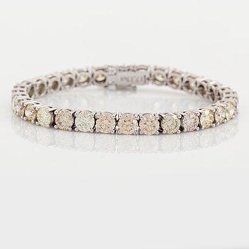 Round brilliant-cut diamond rivière bracelet, with IGI report.