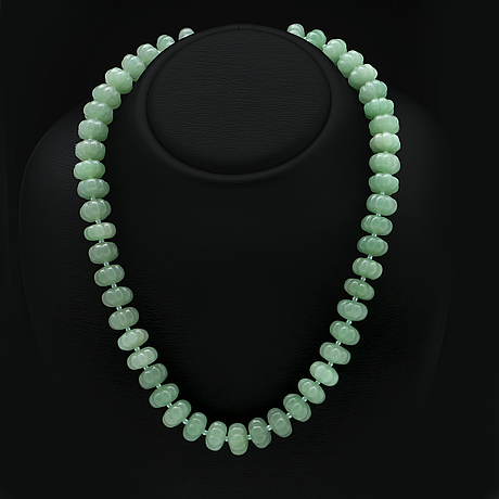 Necklace carved jade beads approx 15 mm and smaller glass beads , clasp metal, approx 50 cm.