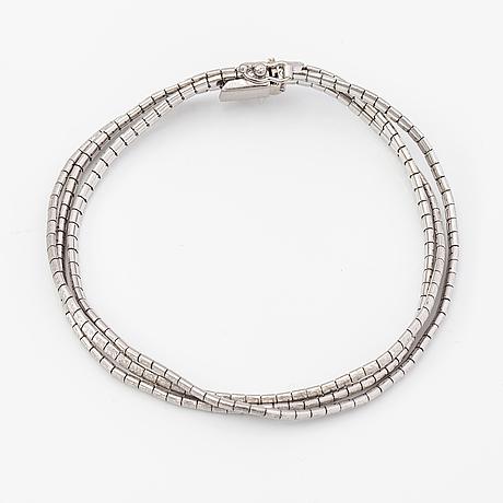 A 14k white gold bracelet. import marked tillander, helsinki 1967.