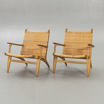 Hans J Wegner, a set of two CH27 oak and rattan armchairs.