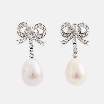 405A. A pair of 18K gold and cultured pearl earrings set with round brilliant-cut diamonds.
