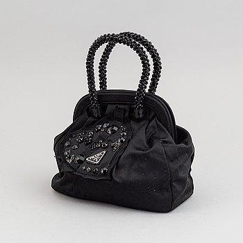 Prada, an evening bag.