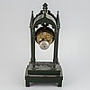 A cast iron gothic revival mantel clock, late 19th century.