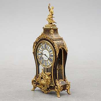 A French Boulle style mantel clock, 19th century.