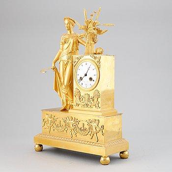 A French Empire gilt bronze mantel clock.