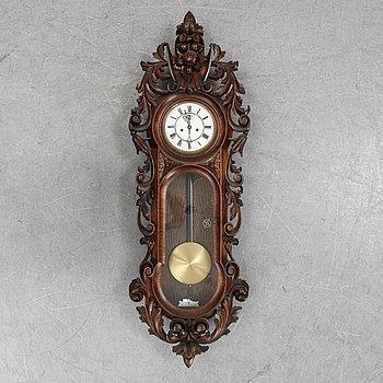 A wall pendulum clock from Gustav Becker, ca 1900.