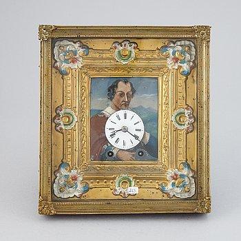 A Schwarzwald area wall pendulum clock with mechanical eye-movment, mid 19thcentury.