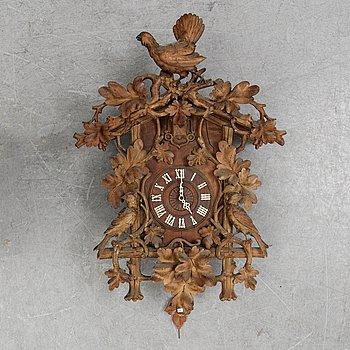 A Black Forest area pendulum wall clock.