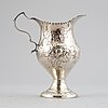 3 silver creamers, a mustard jar and a tray, including goldsmiths & silversmiths co ltd, london 1903.