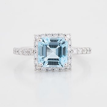 Blue topas and brilliant-cut diamond ring.
