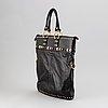 Gucci, a black leather handbag.