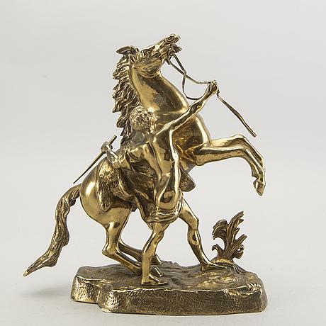 A bronze sculpture after guillaume coustau.